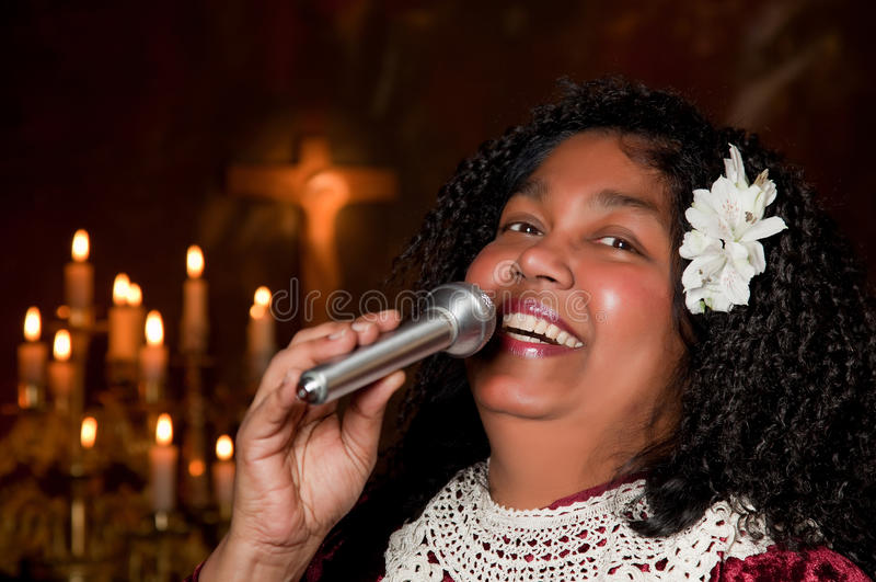 Smiling singer. Negro spiritual gospel singer singing a hymn royalty free stock image
