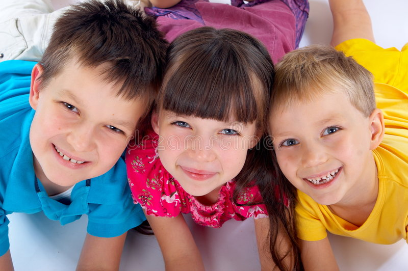 Smiling sister with brothers royalty free stock image
