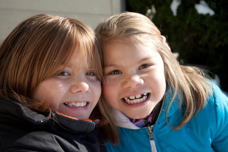 Smiling Sisters stock photo