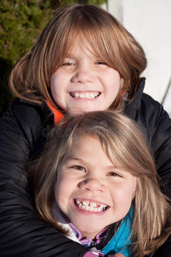 Smiling Sisters royalty free stock photography