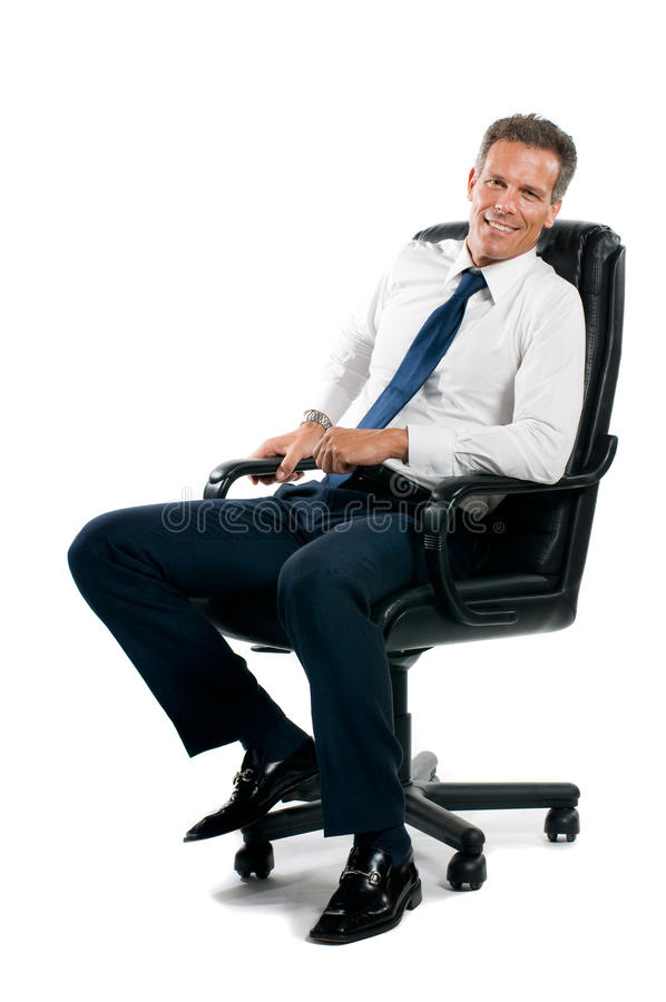 Smiling sit businessman stock photo