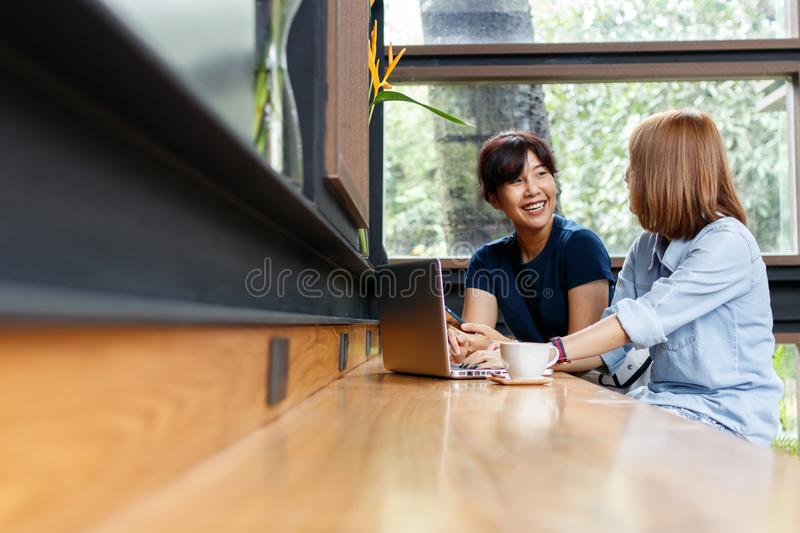 Smiling small business owners woman discussing ideas for project. Smiling small business owners women discussing ideas for project sharing opinions and checking stock images