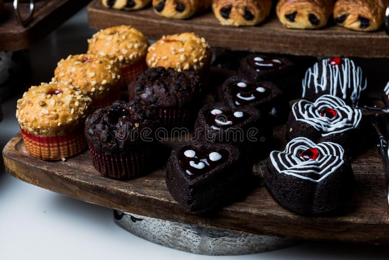Smiling Small sweet chocolate cakes. Ready to be served royalty free stock photo