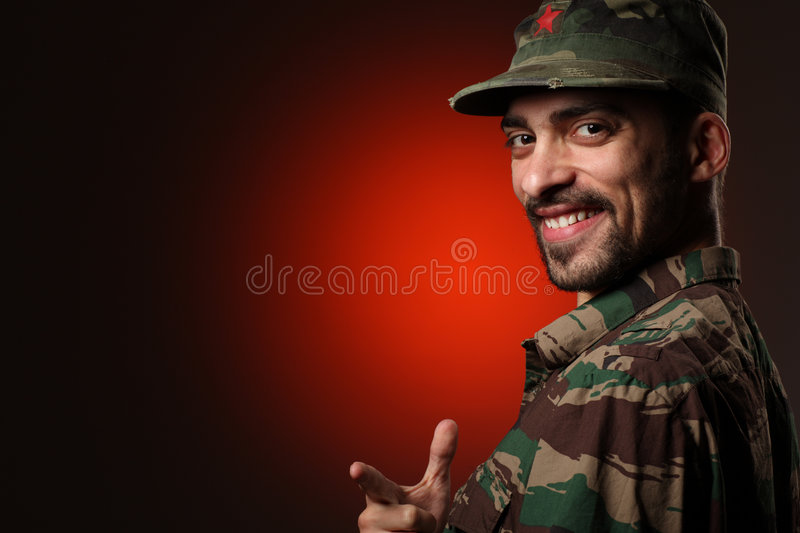 Smiling soldier. Happy smiling soldier looking at camera royalty free stock photo