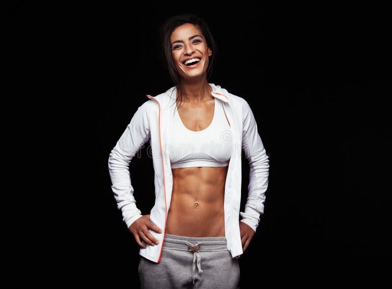 Smiling sportswoman on black background stock photos