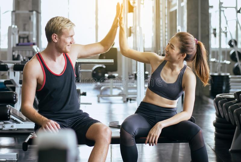 Smiling sporty couple attractive and clap or join hands together,Hand coordination of people motivated,Happy and fun. Smiling sporty couple people attractive and royalty free stock image