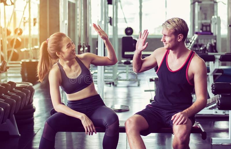 Smiling sporty couple attractive and clap or join hands together,Hand coordination of people motivated,Happy and fun. Smiling sporty couple attractive and clap royalty free stock photo