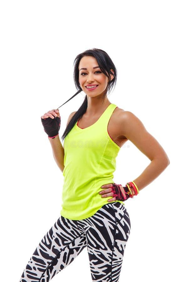 Smiling sporty female isolated on white background. stock photos