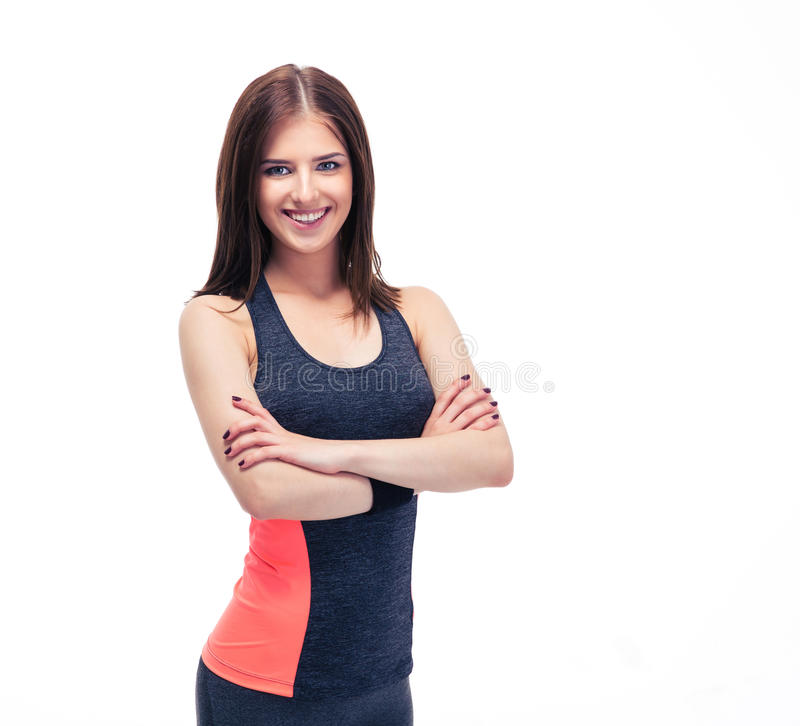 Smiling sporty woman standing with arms folded royalty free stock image