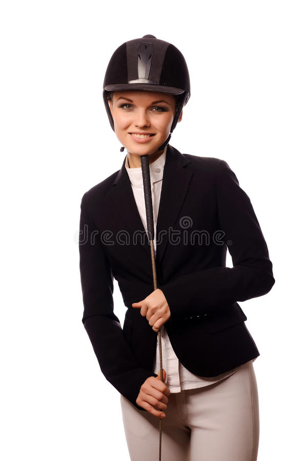 Smiling strict jockey. With thin switch, isolated on white royalty free stock photos