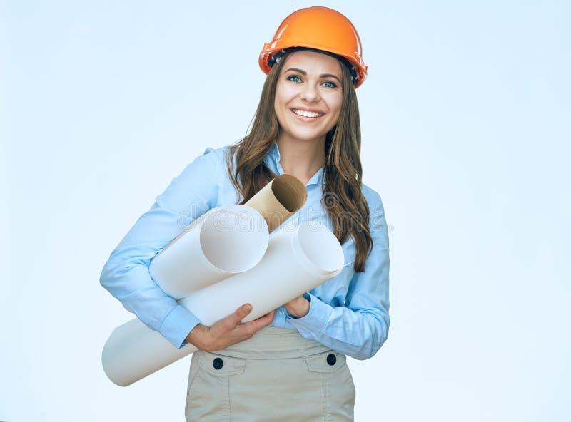 Smiling student arhitect holding paper blueprints. royalty free stock photo