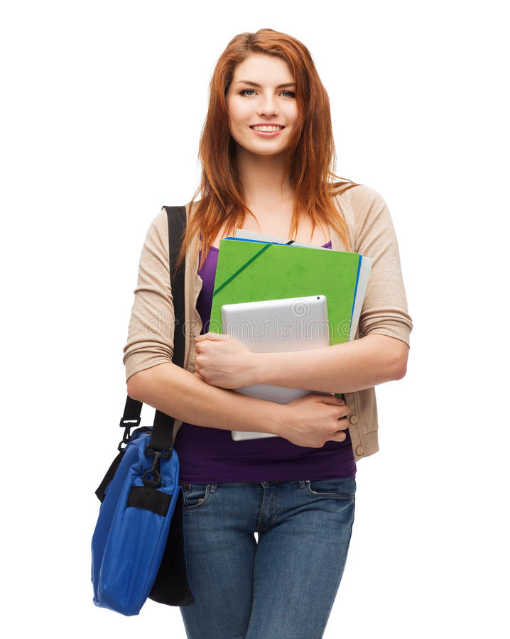 Smiling student with bag, folders and tablet pc. Education, technology and people concept - smiling student with bag, folders and tablet pc computer standing royalty free stock image