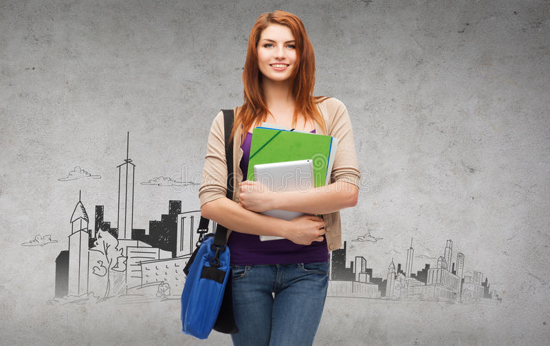 Smiling student with bag, folders and tablet pc. Education, technology and people concept - smiling student with bag, folders and tablet pc computer standing royalty free stock photos