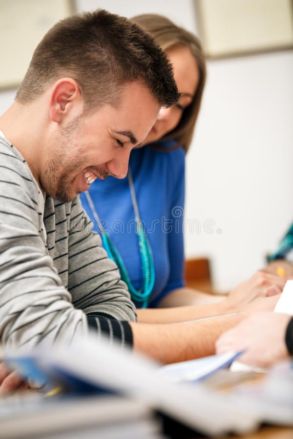 Smiling student on class stock photography