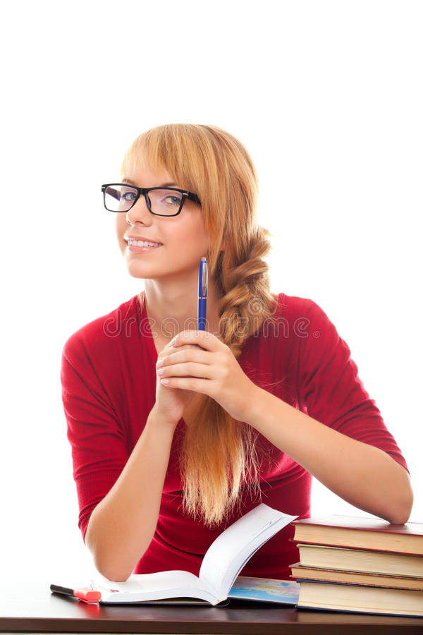 Smiling Student In Eyeglasses With Books And Pen Stock Image
