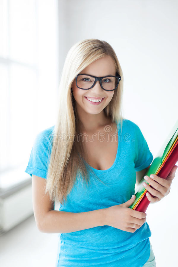 Smiling Student With Folders Stock Photos