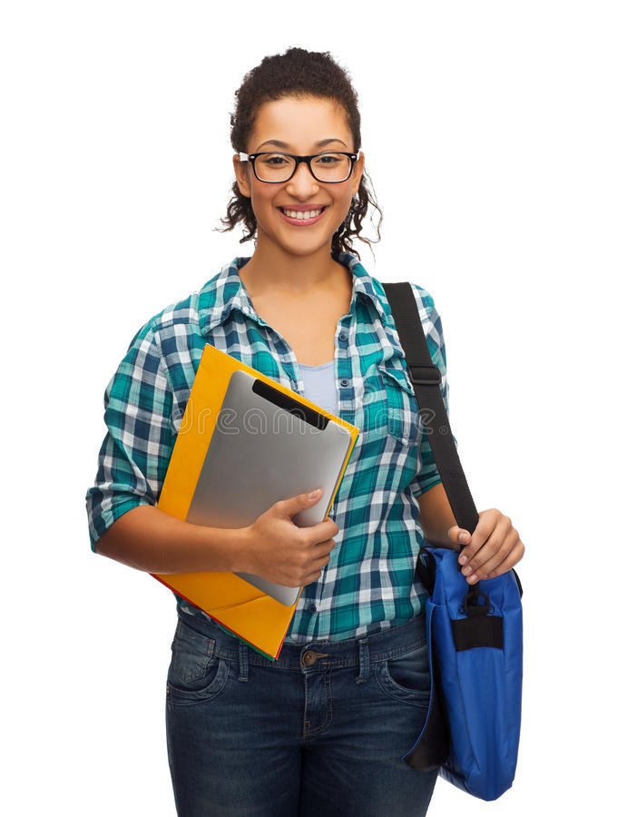 Smiling student with folders, tablet pc and bag. Education, technology and people concept - smiling female african american student in eyeglasses with folders royalty free stock images