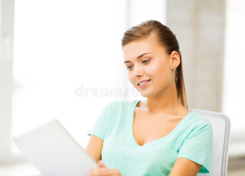 Smiling student girl with tablet pc royalty free stock photos