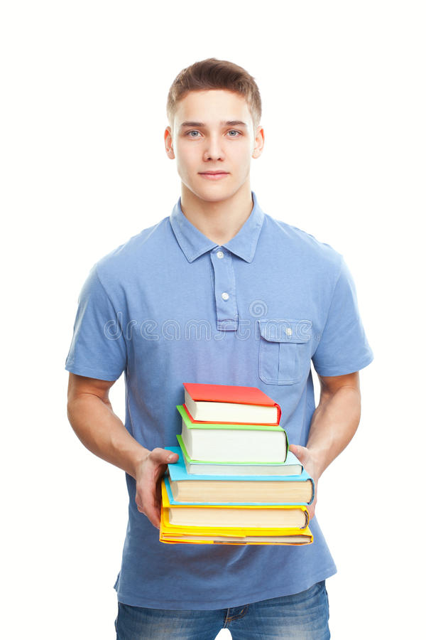 Smiling student holding stack of books isolated on white stock images