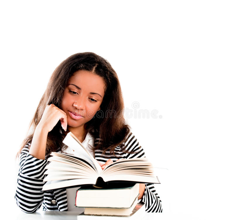 Smiling student with open book reading stock photos