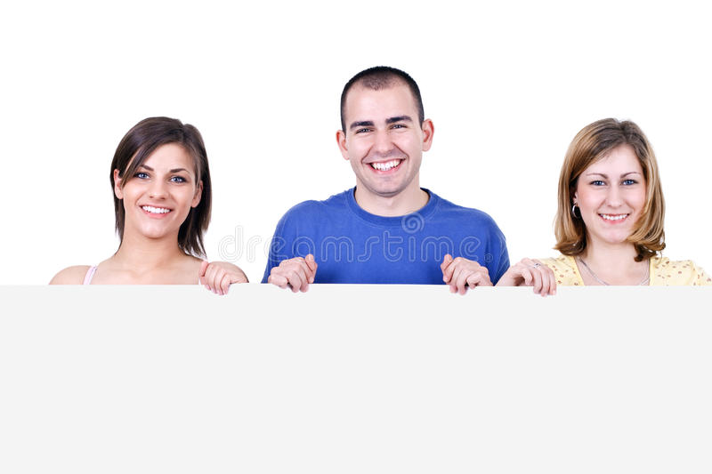 Smiling students holding a billboard royalty free stock images