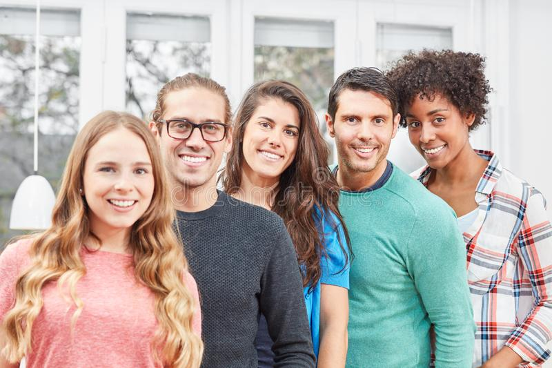Smiling students make up a young team royalty free stock photography