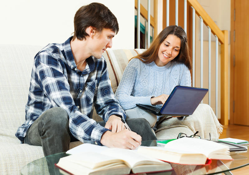 Smiling students preparing for exams. At home royalty free stock image