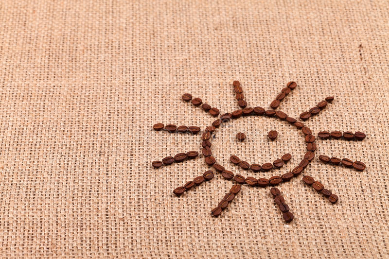 Smiling sun of coffee beans stock photo