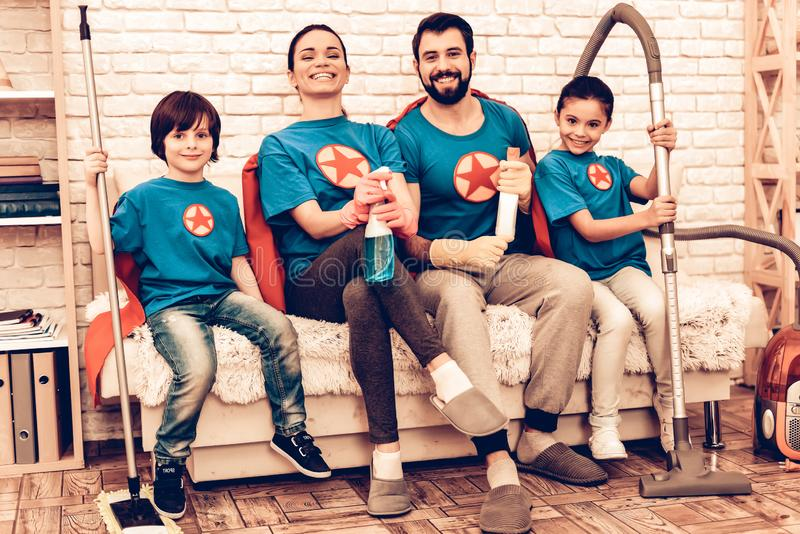 Smiling Superhero Family Cleaning House with Kids. Mother with Kids Washing at Home. Cleaning Day Concept. Cosplay Superheroes. Kids Helping House Chores stock photo