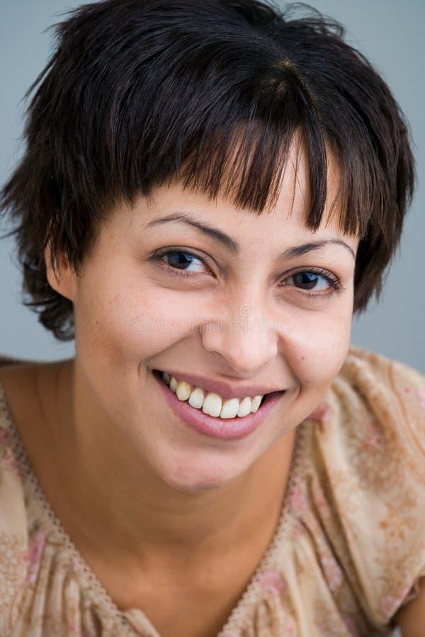 Smiling sweetly stock photo