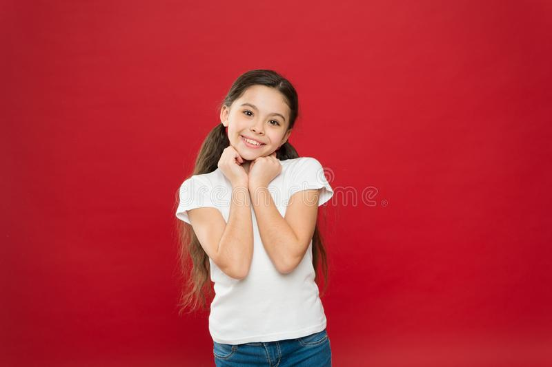 Smiling sweetly. Adorable little girl with no makeup. Beauty look of skincare model. Beauty cosmetics for kids. Pretty royalty free stock photos