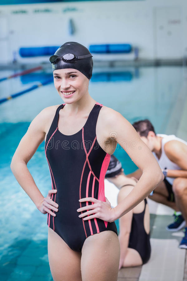 Smiling swimmer looking at the camera stock photography