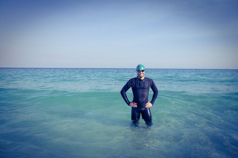 Smiling swimmer in the ocean royalty free stock photography