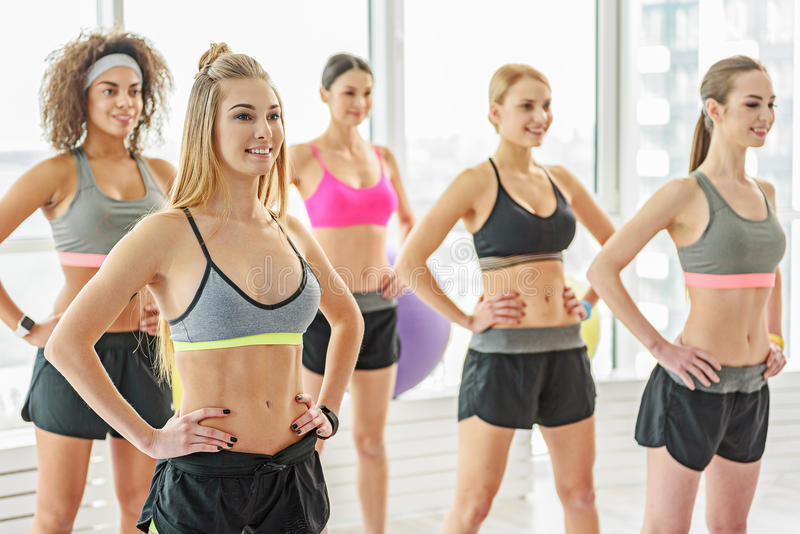 Smiling taut girls in gym stock photography