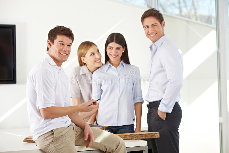 Smiling team of business architects stock photos