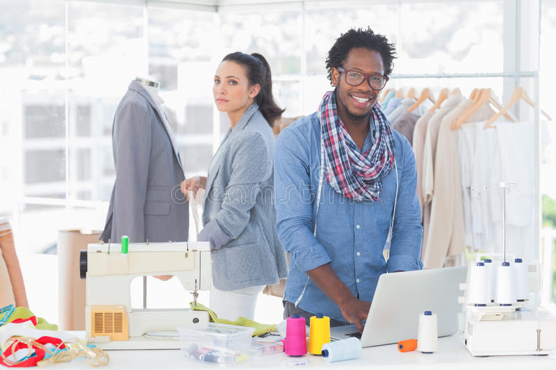 Smiling team of fashion designers royalty free stock images