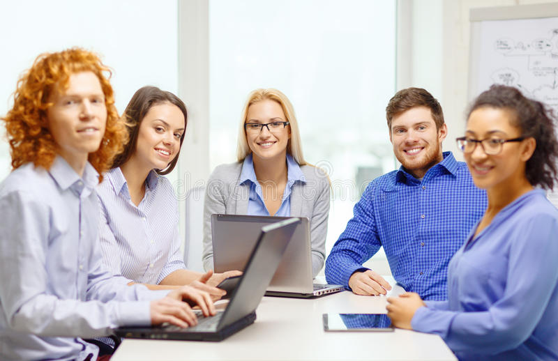 Download Smiling Team With Laptop And Table Pc Computers Stock Photo - Image of many, meeting: 39639512
