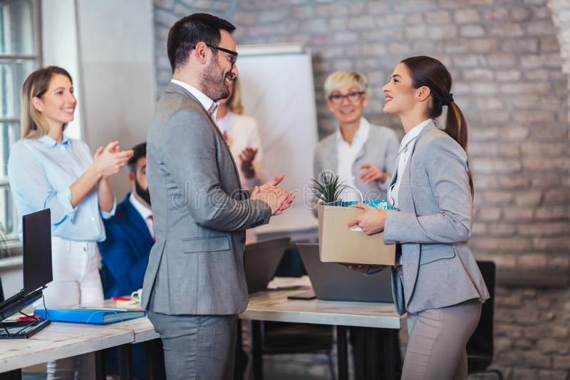 Team leader executive introducing new just hired female employee to colleagues. Smiling team leader executive introducing new just hired female employee to royalty free stock photo
