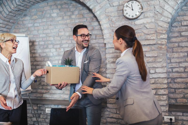 Team leader executive introducing new just hired female employee to colleagues. Smiling team leader executive introducing new just hired female employee to stock photo