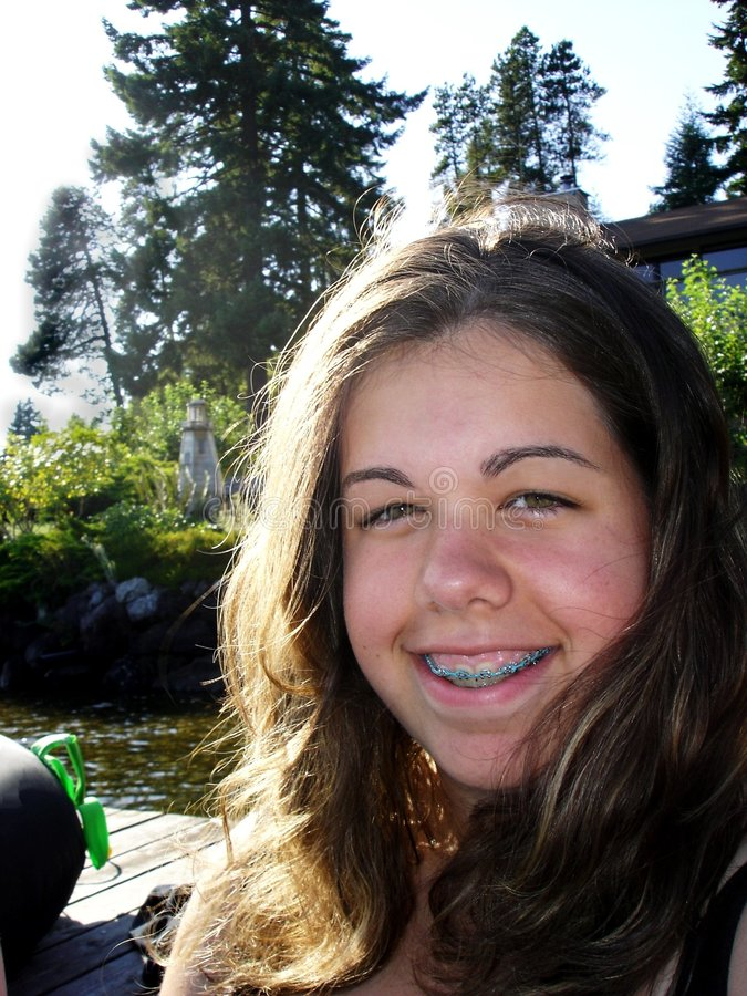 Smiling Teen Girl. A close-up of a teenage girl smiling royalty free stock photos
