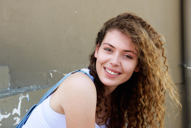 Smiling teen girl with hair blowing in wind royalty free stock images