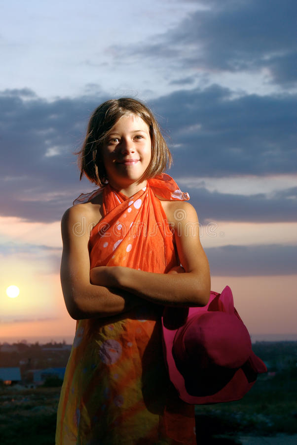 Download Smiling Teen Girl With Hat And Pareo On Sunset Stock Photo - Image: 15415942