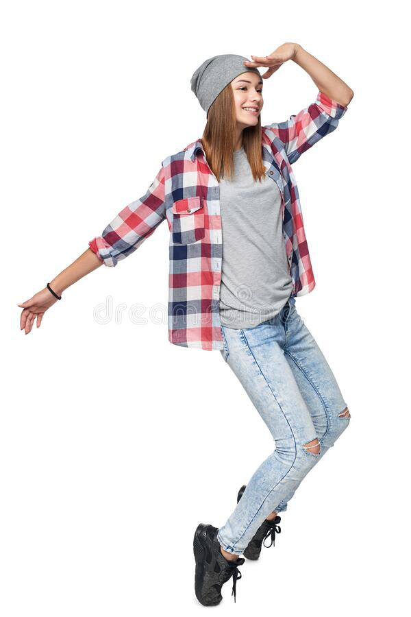 Smiling relaxed teen girl standing in full length royalty free stock photo