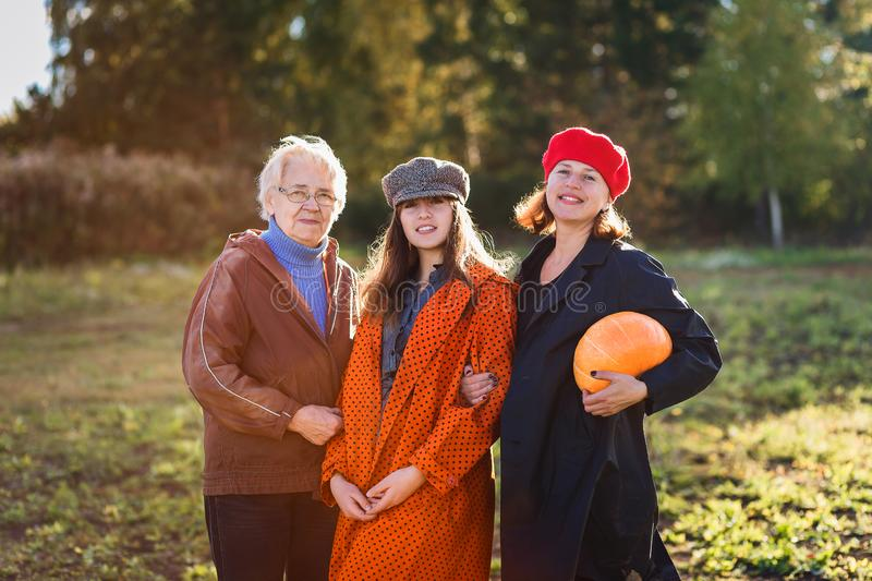 Smiling teen girl, mother and Granny stock image