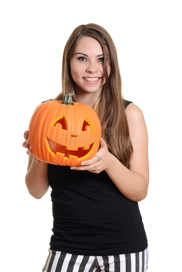 Smiling Teen Girl With A Pumpkin Royalty Free Stock Images