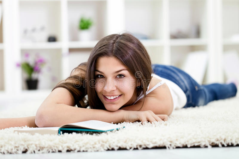 Smiling teen girl relaxing royalty free stock images