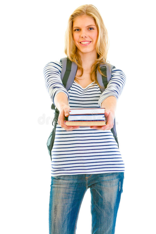 Smiling Teen Girl With Schoolbag Giving Books Stock Images