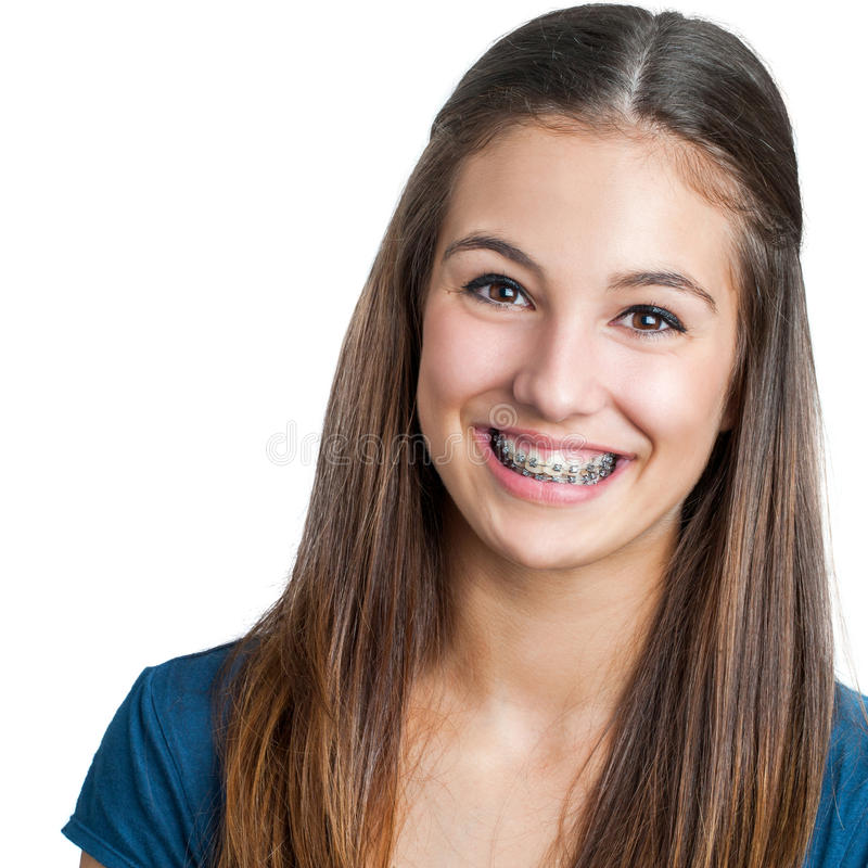 Smiling Teen girl showing dental braces. Close up portrait of Smiling Teen girl showing dental braces.Isolated on white background royalty free stock photos