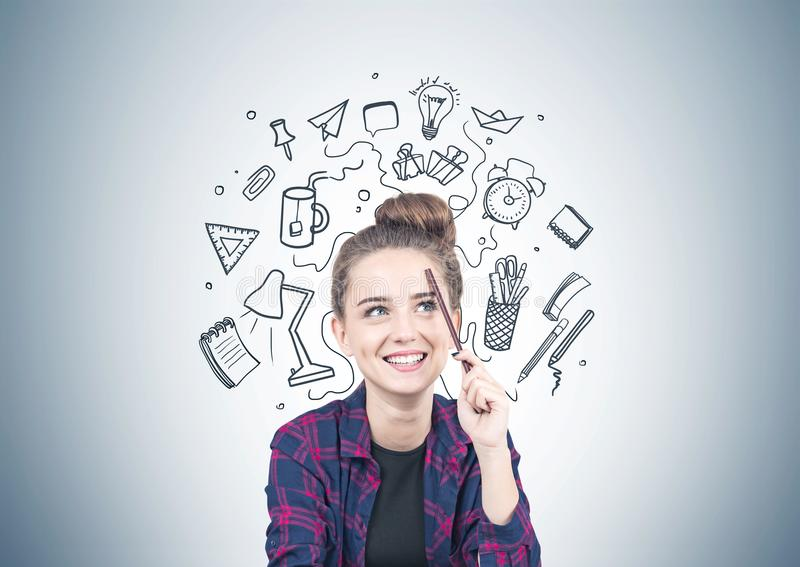 Smiling teen girl thinking, school concept stock photography