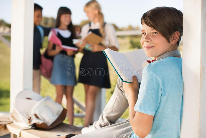 Teenager reading book stock photography